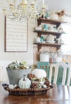 Farmhouse kitchen with succulents and pumpkins for fall