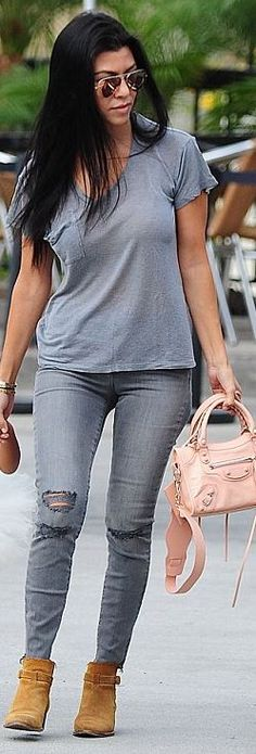 Kourtney Kardashian: Sunglasses – Ray Ban  Purse – Balenciaga  Bracelet – Cartier  Jeans – J Brand  Shoes – Saint Laurent