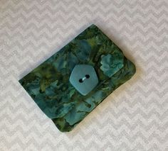 A personal favorite from my Etsy shop https://www.etsy.com/listing/556828167/credit-card-wallet-turquoise-green-batik