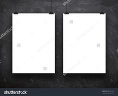 Close-up of two hanged paper sheet frames with clips on blackboard background