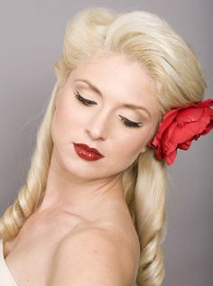 Beautiful retro style for long hair.  Looks like a victory roll/pompadour combo?