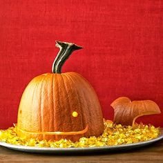 Carved whale pumpkin floating in a sea of candy. Fun ideas:  http://www.completely-coastal.com/2013/10/coastal-sea-jack-o-lanterns.html