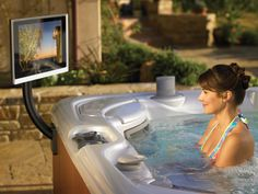Kick back and relax in the backyard. You can watch your favorite shows on a wireless TV right in the #HotSpringSpas Vanguard hot tub!