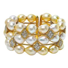 Pearl Diamond Gold Bangle Bracelet -- 18 Karat Yellow and White Gold Bangle Containing 48 Round Brilliant Cut Diamonds Weighing Approximately 5 Carats, F Color, VS Clarity, and 39 Baroque Pearls.