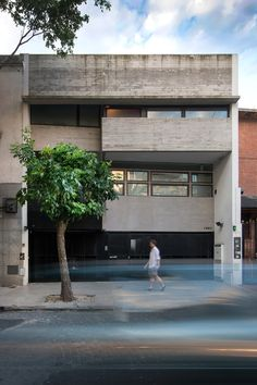 Local architects María Victoria Besonías and Luciano Kruk developed the Two Houses Conesa project for a pair of families who own a site sandwiched between existing buildings in the residential district of the Argentinian city.