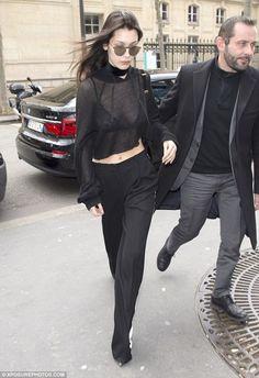 Bella Hadid flashes bra in cropped jumper as Gigi sexes up denim coat