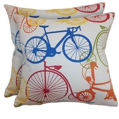 Set of two plush down pillows with a multicolor bicycle motif.   Product: Set of 2 pillowsConstruction Material: Cotton cover and down fillColor: MultiFeatures:  Inserts includedHidden zipper closureMade in the USA Dimensions: 18 x 18 eachCleaning and Care: Spot clean. Dry clean recommended.