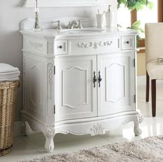 classic style antique white Fairmont Bathroom Sink Vanity — Dimensions: 36 x 21 x This Antique white finish Fairmont Bathroom Vanity has a traditional antique look with ornate molding throughout. Bathroom Vanity Store, Master Suite Bathroom, White Vanity Bathroom, Vanity Sink, Small Bathroom, Bathroom Ideas, Bathroom Vanities, Bathroom Designs, Bathroom Makeovers