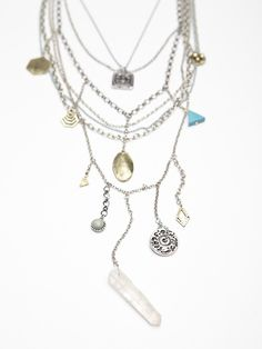 Draped layer, mixed-metal chains... Makes for a great boho vintage piece!