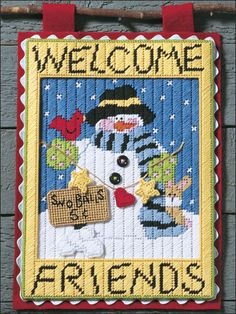 Welcome Friends Banner Plastic Canvas Pattern Download from e-PatternsCentral.com -- This charming snowman and his forest-friend helpers will welcome your guests with the promise of homegrown country comfort!
