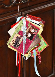 """A cute way to show off Christmas cards from previous years. Using a 5"""" neck ring with hooks & ribbon...cute & super easy to make!"""