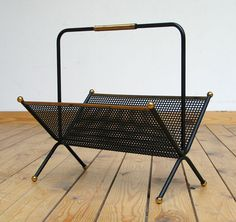 1950 metal magazine rack eames era | 20th century Modern online gallery. Featuring a large and varied selection of vintage design and architect furniture. | Shipping worldwide | http://www.furniture-love.com/vintage/objects/