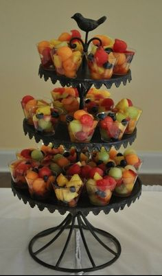 Just buy small plastic glasses and fill them up. Display on tiered cupcake stand -- Would be perfect for a shower or brunch Cute Fruit, Fruta Fresca, Fruit Displays, Plastic Cups, Bridal Shower Venues, Bridal Shower Recipes, Food For Bridal Shower, Bridal Brunch Shower, Bridal Shower Treats
