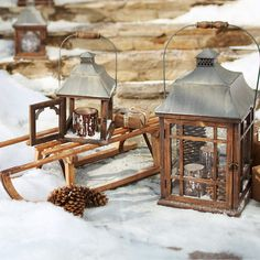 Lanterns filled with pinecones & snow.