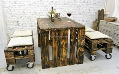 This awesome idea is not only perfect for the proper decoration of a home, but for a restaurant as well. The idea of seats on the wheel is innovative and the wooden pallet furniture is showing the great work of the creator.