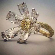 repost via @instarepost20 from @davidmorrislondon It's summer. Let's celebrate with our asymmetrical yellow #diamond #daisy ring.