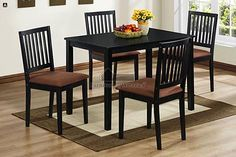 5 Pc. Portland IV in a Mission Style Design Black Wood Finish Rectangular Table Dining Set. This set features a dining table and 4 - side chairs upholstered microfiber seats. The set is made out of solid wood in a black wood finish with 4 sturdy wood t