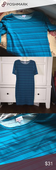 LuLaRoe Julia Dress Striped Small Blue Blue on blue striped LLR Julia dress in size small. Love this with a belt and booties, but I have another striped Julia...lol. When I examine super-close, I see a tiny bit of pilling on the arms (pic 4), but otherwise looks great! *Open to trades for XXS/XS Nicoles or Julias!* LuLaRoe Dresses Midi