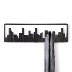"Hooked on Skyscrapers - The Space Between Collection - Dot & Bo $24.99 | Every skyscraper flips forward so you can hang an array of items on the hooks. These hooks are also designed to be sturdy: each one holds up to 5 pounds. Includes mounting hardware. Dimensions: 6"" Height, 19.5"" Depth"