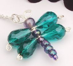 Beautiful faceted glass beads in a deep teal colour make the wings of this dragonfly, the body is made from shimmery purple beads and wire. The dragonfly measures aprox. and hangs on a sterling silver, chain. Beaded Dragonfly, Dragonfly Necklace, Diy Necklace, Baby Dragonfly, Dragonfly Pendant, Wire Jewelry, Beaded Jewelry, Jewelery, Jewelry Necklaces