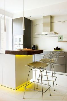 'Bertoia' aluminium bar stools by Knoll stand at the cantilevered kitchen island in this Little Venice apartment, a collaboration between Juliette Byrne, Newman Zieglmeier and Sally Storey at John Cullen Lighting. This 50s design classic is available from Nest, where prices start at £972 for a stool with seat pad. They measure 104 x 54 x 58cm. The oak table is from The Dining Chair Company, while the units are Bulthaup