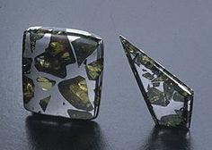Happy Birthday to everyone born in August. Peridot is your birthstone and here are peridot samples from the Esquel pallasite meteorite.