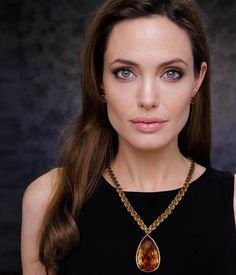 "33f2f260cf3ba Angelina Jolie wearing the ""Jolie Citrine Necklace"" that she donated to the  Smithsonian. The yellow gold necklace features 64 graduated bezel-set  cushion ..."