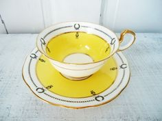 Sunny Yellow Tea Cup and Saucer by SwirlingOrange11