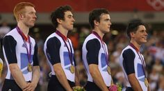Edward Clancy, Geraint Thomas, Steven Burke and Peter Kennaugh celebrate of the Great Britain - Men's Team Pursuit Track Cycling Final