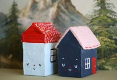 so adorable, holly leonardson, little houses- looks like a small milk or one of those heavy whipping cream containers at the supermarket that's been paper mached over and painted. Cool!