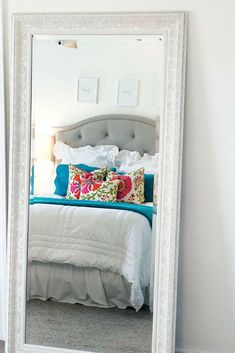 White leaning full length mirror for bedroom. White and turquoise bedding. Full Length Mirror In Bedroom, Turquoise Bedding, Tall Mirror, White Bedroom Decor, Living Room Mirrors, Floral Throw Pillows, Little Girl Rooms, Down Pillows, Decorating Your Home