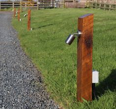 A more rustic one needed but I like the idea of upright sleepers having lights in them for the driveway