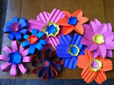 Construction paper flowers made for the spring library bulletin board at school. - Have the students create these to add to spring bulletin board - as the border, accents or both. Bonus - have them write their favorite book in the center