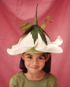 Turn your little girl into a beautiful bloom for Halloween with an easy-to-make paper rose costume. - this would look awesome with fairy wings!