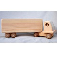 This handcrafted eight-wheeler Wooden Toy Tractor-Trailer Truck is made in Maine of thick native white pine, which has been hand-sanded to a satin smooth natural finish. This truck has an open back fo