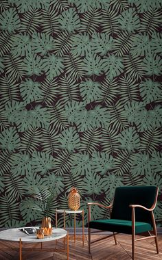 Indulge in dark tropical vibes with this beautiful wallpaper. The wonderful jungle greens of leaves are set off against a pitch black background. Accessorise with glimmers of gold for a truly luxurious feel to your home.