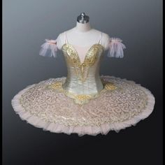 This tutu is a highly professional stage costume. It is suitable for any classical variation, but especially for the role of the Gold Fairy in Sleeping Beauty, for the ballet Raymonda, Paquita, Cinder