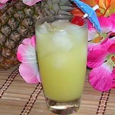 Coconut-flavored rum, pineapple juice, and orange juice make a great summer cocktail.