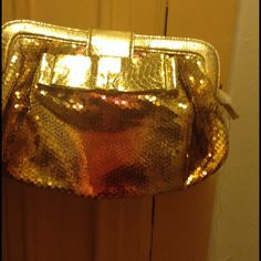 Gold sequin clutch Multicolor sequin clutch with bow  in front back plain metallic gold leatherette beautiful for evening out  a must see  NWOT gold fuchsia and bronze  sequins Bags