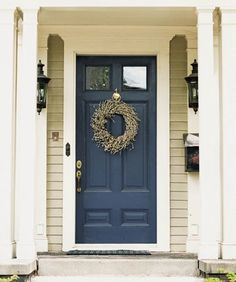 Front Door Paint Colors - Want a quick makeover? Paint your front door a different color. Here a pretty front door color ideas to improve your home's curb appeal and add more style! Porta Colonial, Colonial Front Door, Casa Petra, Tan House, Pintura Exterior, Painted Front Doors, Navy Front Doors, Painted Exterior Doors, Exterior Front Doors