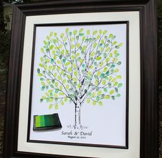 Check out www.guesttree.com for this beautiful guest book alternative. The print is personalized with your names and date, then your guests personalize it further with their thumb/finger prints (they can sign it near their print also).