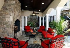 outdoor living room.  Love the red.