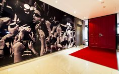 MCM | The Bold Collective | Office entrance red carpet, red double doors, black and white mural