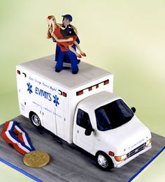 For my fiance's groom's cake, i would like it to be a police car with us on top of it! He is my American Hero, a hero who protects and serves our community. Im so proud of him every day!