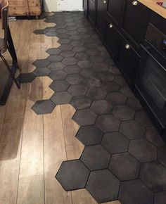 Flooring Transitions From Wood to Tile. Light wood with hexagonal dark light tiles are used to decorate your flooring. Room Tiles, Bathroom Floor Tiles, Wood Bathroom, Shower Floor, Bathroom Black, Bathroom Ideas, Bathroom Colors, Bathroom Cabinets, Wood Cabinets