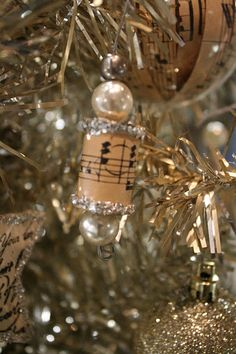 Cover empty, wooden spools with sheet music and embellish them with glitter and pearls for your tree.This site has other charming ornaments for a lovely Sheet Music Christmas Tree!