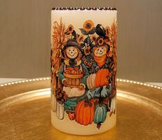 LED Pillar Candle With Scarecrows, Pumpkins, Sunflowers, Fall Leaves And More by DontForgetTheFlowers on Etsy Flameless Candles, Pillar Candles, Halloween Candles, Halloween Decorations, Wrapping Paper Bows, Scarecrows, 4 Hours, Fall Leaves, Pumpkin Decorating