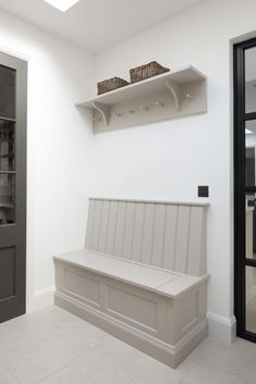 The boot room area at the Hampstead kitchen project has bench seating which provides a place to sit and put on shoes and is ideal for storing additional footwear and bags. Kitchen Seating, Kitchen Benches, Kitchen Booths, Porch Interior, Interior Design, Boot Room Utility, Porch Storage, Hallway Storage Bench, Hall Bench