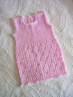 Beautiful knit baby dress via Ravelry.