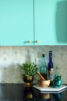 #repainted #kitchen #cupboards #turquoise and #black respray by Paint it Like New! Inc.
